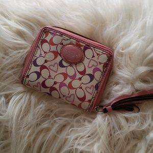 Coach pink coated canvas zip around small wallet